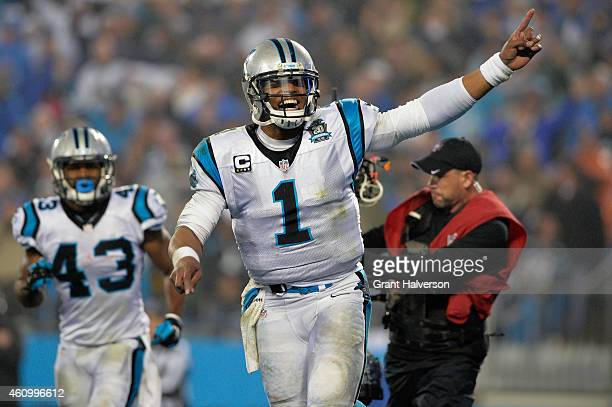 Cam Newton and Fozzy Whittaker of the Carolina Panthers celebrate during their NFC Wild Card Playoff game against the Arizona Cardinals at Bank of...