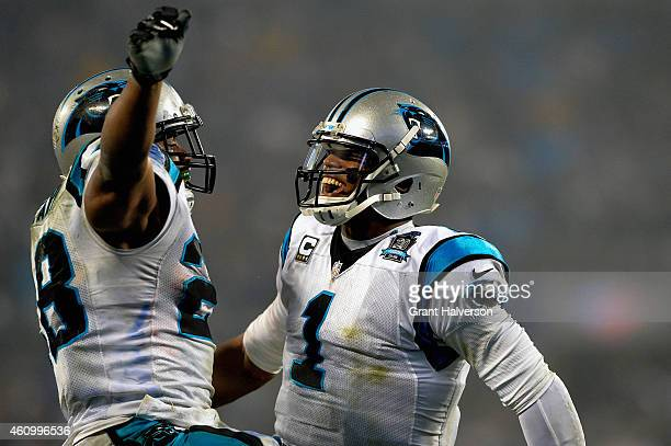 Cam Newton and Jonathan Stewart of the Carolina Panthers celebrate during their NFC Wild Card Playoff game against the Arizona Cardinals at Bank of...