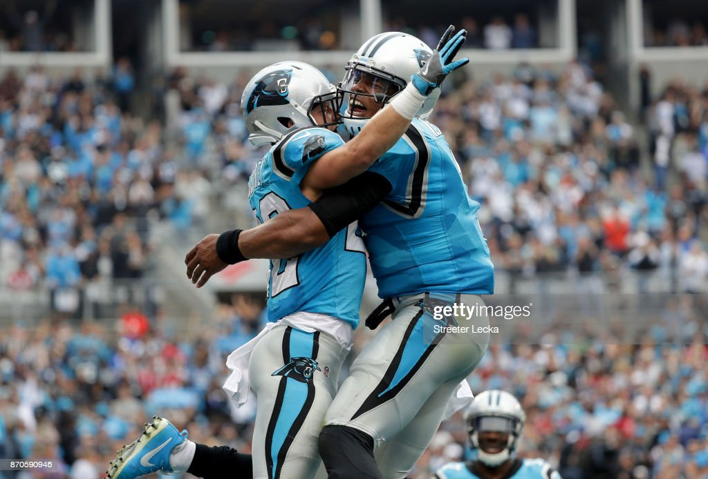 Cam Newton #1 and teammate Christian McCaffrey #22 of the Carolina Panthers celebrate after a touchdown against the Atlanta Falcons during their game at Bank of America Stadium on November 5, 2017 in Charlotte, North Carolina.