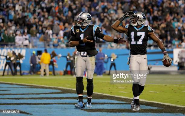 Cam Newton and teammate Devin Funchess of the Carolina Panthers celebrate a touchdown against the Miami Dolphins in the third quarter during their...