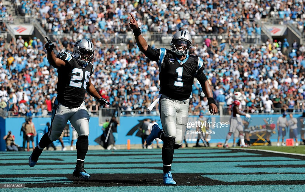 Cam Newton #1 and teammate Jonathan Stewart #28 of the Carolina Panthers celebrate a 1st quarter touchdown run against the Arizona Cardinals during their game at Bank of America Stadium on October 30, 2016 in Charlotte, North Carolina.