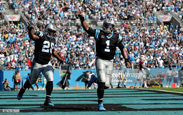 Cam Newton and teammate Jonathan Stewart of the Carolina Panthers celebrate a 1st quarter touchdown run against the Arizona Cardinals during their...