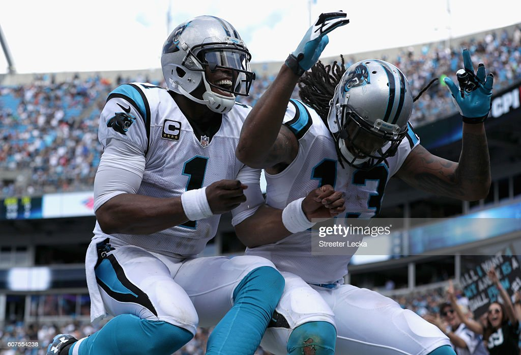 Cam Newton #1 and teammate Kelvin Benjamin #13 of the Carolina Panthers celebrate a touchdown against the San Francisco 49ers in the 3rd quarter during their game at Bank of America Stadium on September 18, 2016 in Charlotte, North Carolina.