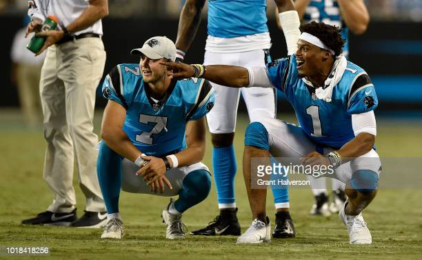Cam Newton and teammate Kyle Allen of the Carolina Panthers react after a third quarter touchdown against the Miami Dolphins during the game at Bank...