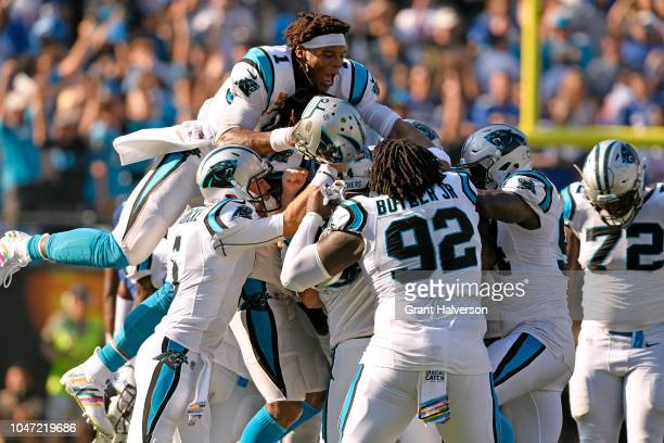 Cam Newton and teammates pile on kicker Graham Gano of the Carolina Panthers after his gamewinning 63yard field goal against the New York Giants...