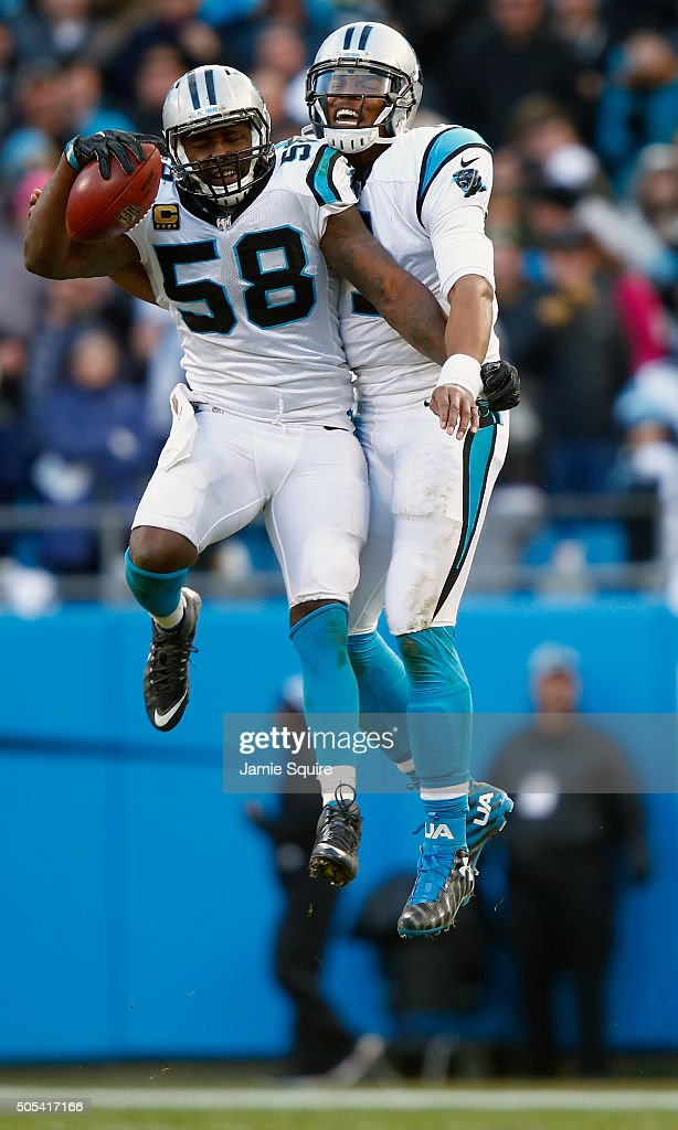 Cam Newton #1 and Thomas Davis of the Carolina Panthers celebrate their win after defeating the Seattle Seahawks 31-24 in the NFC Divisional Playoff Game at Bank of America Stadium on January 17, 2016 in Charlotte, North Carolina.