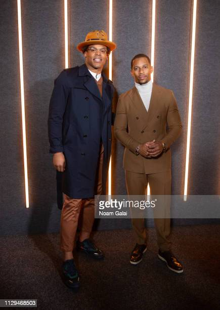 Cam Newton and Victor Cruz attend the BOSS Womenswear Menswear fashion show during New York Fashion Week on February 13 2019 in New York City