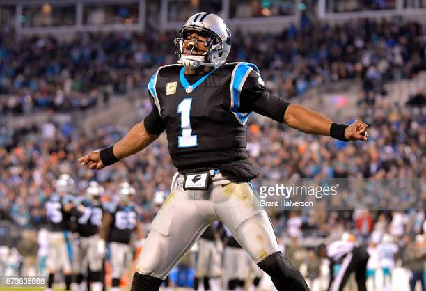 Cam Newton celebrates after a touchdown against the Miami Dolphins during their game at Bank of America Stadium on November 13 2017 in Charlotte...