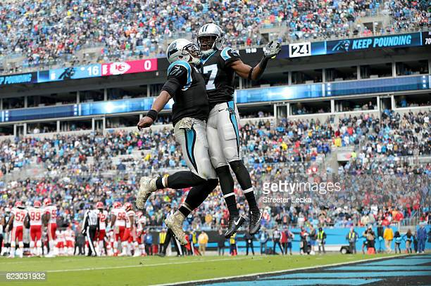Cam Newton celebrates with teammate Devin Funchess of the Carolina Panthers after a touchdown pass during their game against the Kansas City Chiefs...