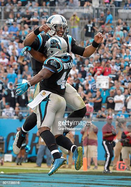 Cam Newton celebrates with teammate Fozzy Whittaker of the Carolina Panthers after a 3rd quarter touchdown against the Atlanta Falcons during their...
