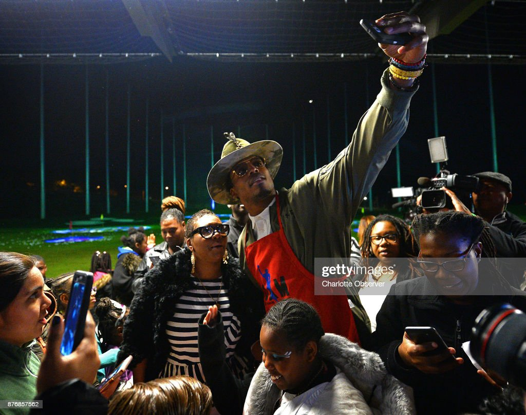 84a432a9 Cam Newton, center, stops to pose for selfies with children and ...