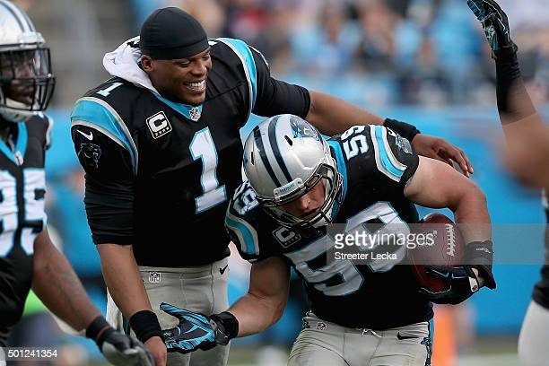 Cam Newton congratulates teammate Luke Kuechly of the Carolina Panthers after Kuechly made an interception in the 3rd quarter during their game...