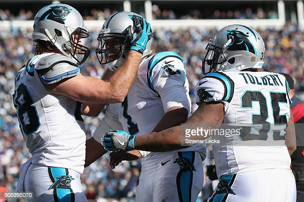 Cam Newton Greg Olsen and Mike Tolbert of the Carolina Panthers celebrate after a touchdown against the Seattle Seahawks in the 2nd quarter during...