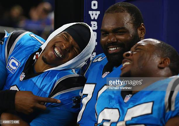 Cam Newton Michael Oher and Mike Tolbert of the Carolina Panthers laugh during a 3314 win against the Dallas Cowboys at ATT Stadium on November 26...