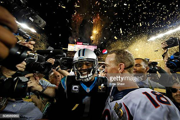 Cam Newton of the Carolina Panthers and Peyton Manning of the Denver Broncos speak on the field after Super Bowl 50 at Levi's Stadium on February 7...
