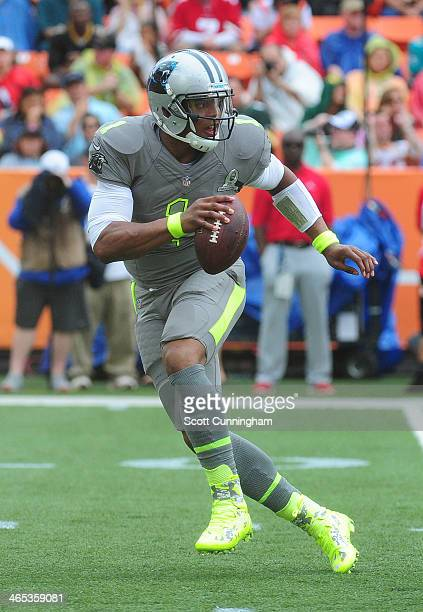 Cam Newton of the Carolina Panthers and Team Sanders scrambles against the Team Rice during the 2014 Pro Bowl at Aloha Stadium on January 26, 2014 in...