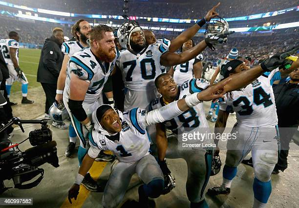 Cam Newton of the Carolina Panthers and teammates celebrate a 2716 victory against the Arizona Cardinals after their NFC Wild Card Playoff game at...