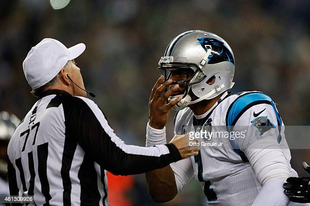 Cam Newton of the Carolina Panthers argues with referee Terry McAulay against the Seattle Seahawks during the 2015 NFC Divisional Playoff game at...