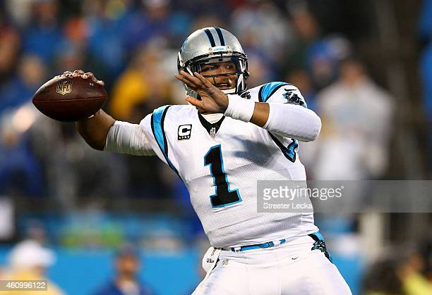 Cam Newton of the Carolina Panthers attempts a pass during their NFC Wild Card Playoff game against the Arizona Cardinals at Bank of America Stadium...