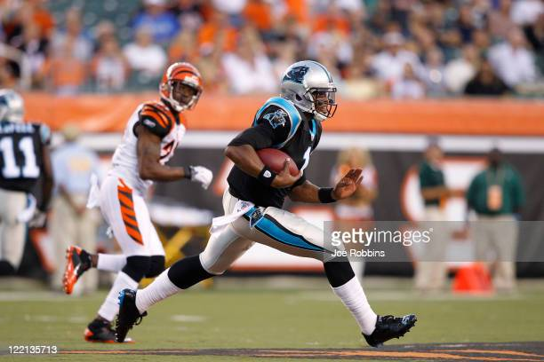 Cam Newton of the Carolina Panthers breaks free for a 26-yard run in the first half of an NFL preseason game against the Cincinnati Bengals at Paul...