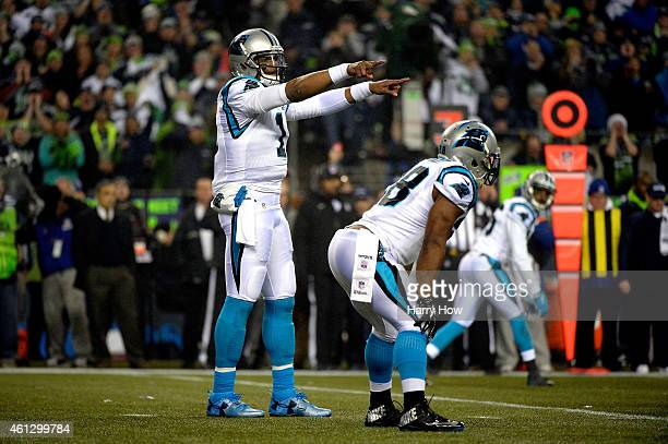 Cam Newton of the Carolina Panthers calls a play in the first quarter against the Seattle Seahawks during the 2015 NFC Divisional Playoff game at...