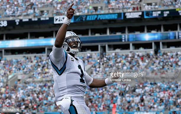 Cam Newton of the Carolina Panthers celebrates a 3rd quarter touchdown pass against the San Francisco 49ers during their game at Bank of America...
