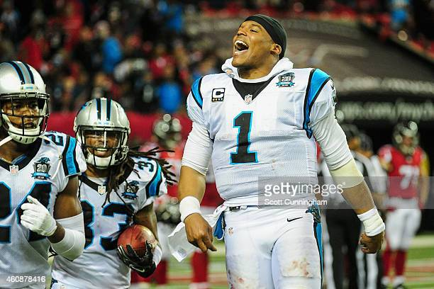 Cam Newton of the Carolina Panthers celebrates a interception return for a touchdown by Tre Boston in the second half against the Atlanta Falcons at...