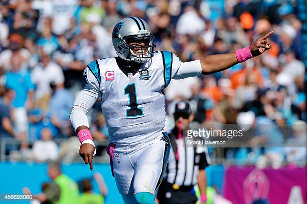 Cam Newton of the Carolina Panthers celebrates a third quarter Panther touchdown against the Chicago Bears during their game at Bank of America...