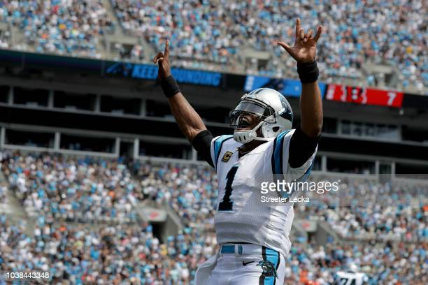 Cam Newton of the Carolina Panthers celebrates a touchdown against the Cincinnati Bengals in the first quarter during their game at Bank of America...