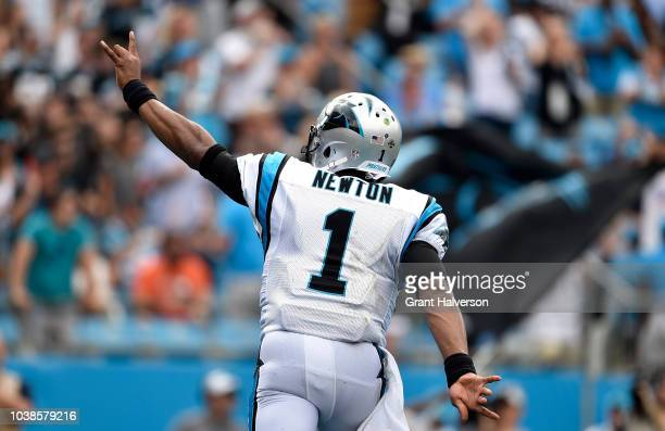 Cam Newton of the Carolina Panthers celebrates a touchdown against the Cincinnati Bengals in the second quarter during their game at Bank of America...
