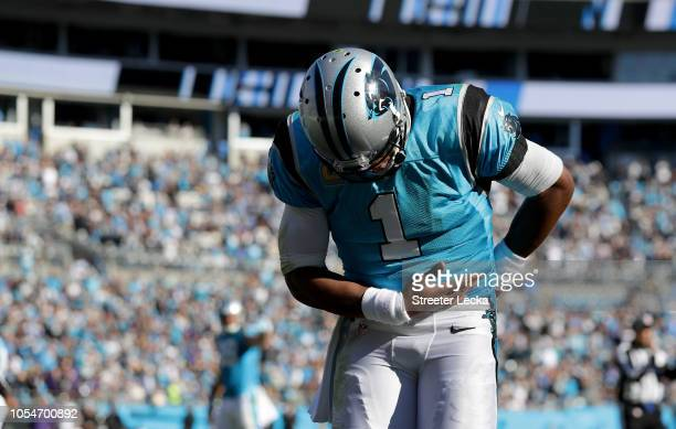 Cam Newton of the Carolina Panthers celebrates a touchdown against the Baltimore Ravens in the fourth quarter during their game at Bank of America...
