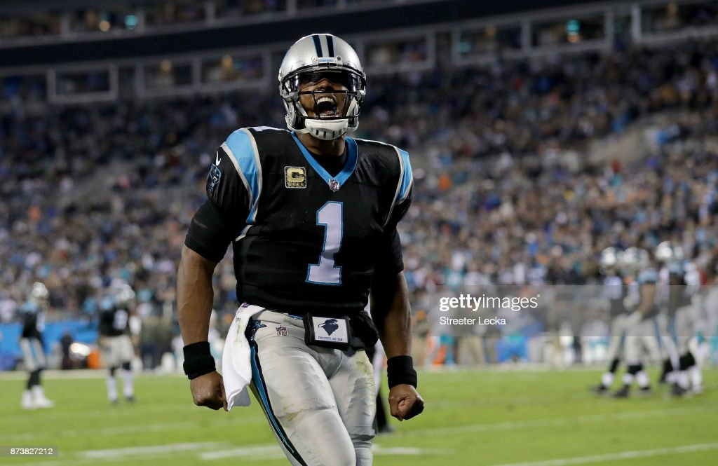 Cam Newton #1 of the Carolina Panthers celebrates a touchdown against the Miami Dolphins in the second quarter during their game at Bank of America Stadium on November 13, 2017 in Charlotte, North Carolina.