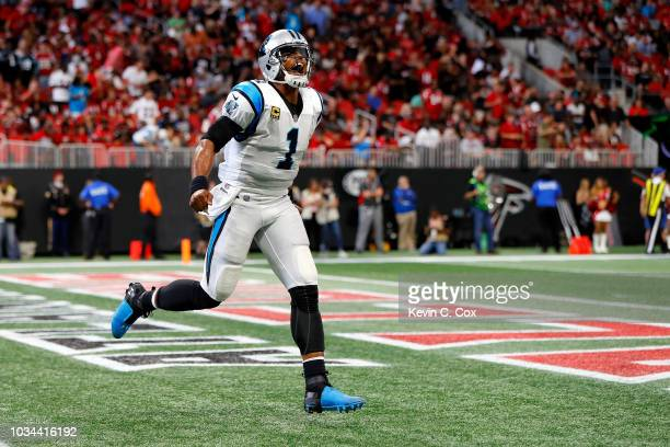 Cam Newton of the Carolina Panthers celebrates a touchdown during the first half against the Atlanta Falcons at Mercedes-Benz Stadium on September...