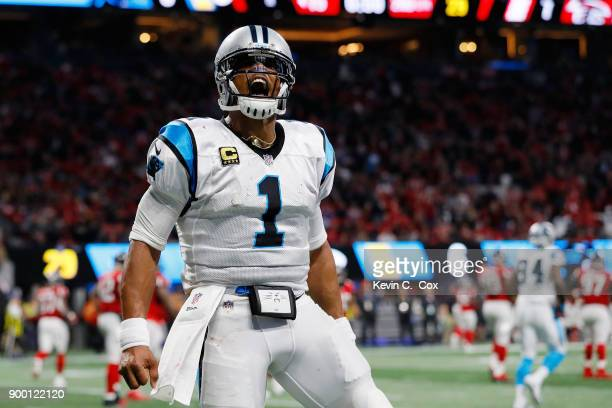 Cam Newton of the Carolina Panthers celebrates a touchdown during the first half against the Atlanta Falcons at Mercedes-Benz Stadium on December 31,...