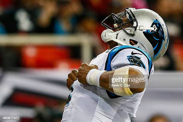 Cam Newton of the Carolina Panthers celebrates a touchdown in the first half against the Atlanta Falcons at the Georgia Dome on December 28 2014 in...