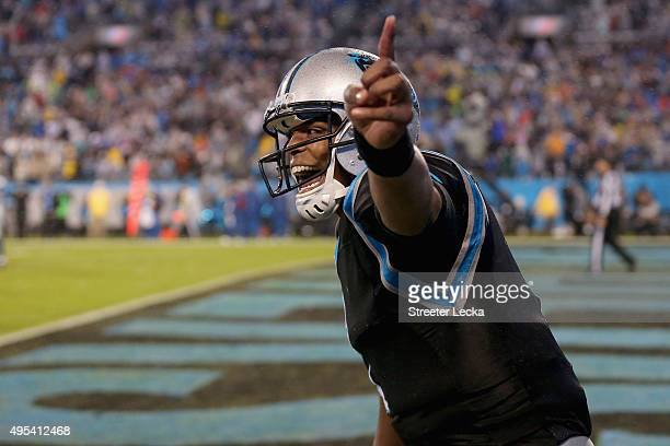 Cam Newton of the Carolina Panthers celebrates after a 3rd quarter passing touchdown against the Indianapolis Colts at Bank of America Stadium on...