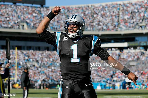 Cam Newton of the Carolina Panthers celebrates after a touchdown pass to Steve Smith in the second quarter against the San Francisco 49ers during the...