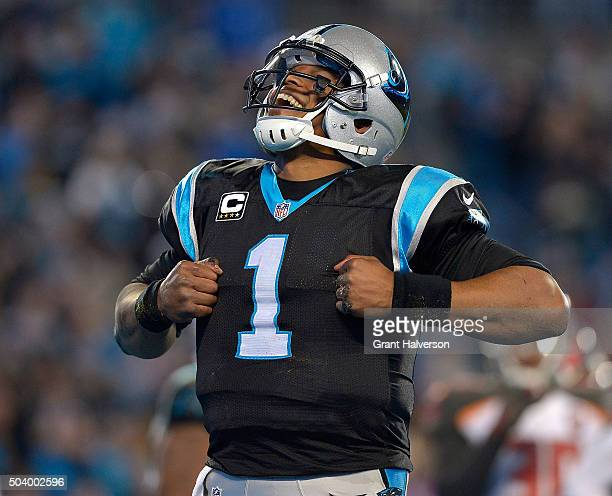 Cam Newton of the Carolina Panthers celebrates after a touchdown against the Tampa Bay Buccaneers during their game at Bank of America Stadium on...