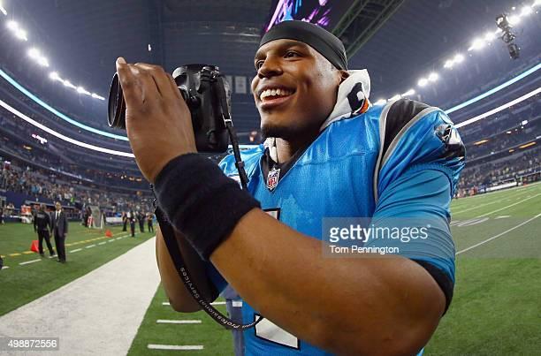 Cam Newton of the Carolina Panthers celebrates after beating the Dallas Cowboys 3314 at ATT Stadium on November 26 2015 in Arlington Texas