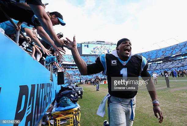 Cam Newton of the Carolina Panthers celebrates after defeating the Atlanta Falcons 380 at Bank of America Stadium on December 13 2015 in Charlotte...