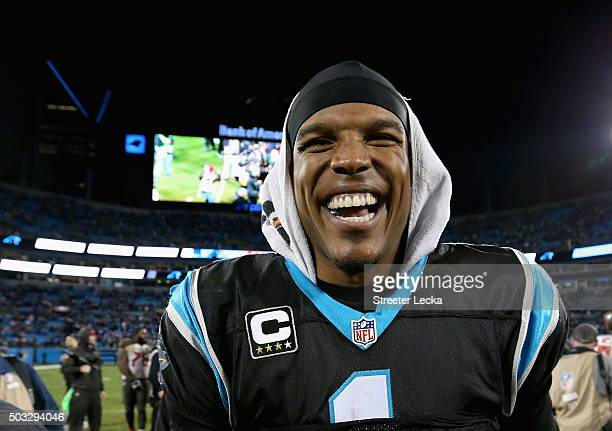 Cam Newton of the Carolina Panthers celebrates after defeating the Tampa Bay Buccaneers at Bank of America Stadium on January 3 2016 in Charlotte...