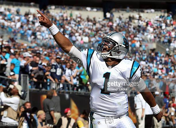 Cam Newton of the Carolina Panthers celebrates after his team scores a touchdown against the Dallas Cowboys during their game at Bank of America...