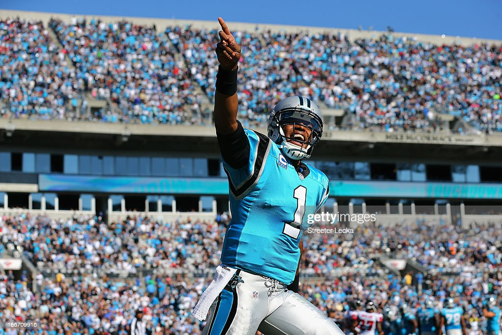 Cam Newton #1 of the Carolina Panthers celebrates after his team scores a touchdown against the Atlanta Falcons during their game at Bank of America Stadium on November 3, 2013 in Charlotte, North Carolina.