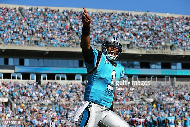 Cam Newton of the Carolina Panthers celebrates after his team scores a touchdown against the Atlanta Falcons during their game at Bank of America...