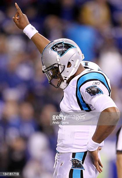 Cam Newton of the Carolina Panthers celebrates after running for a touchdown during the game against the Indianapolis Colts at Lucas Oil Stadium on...