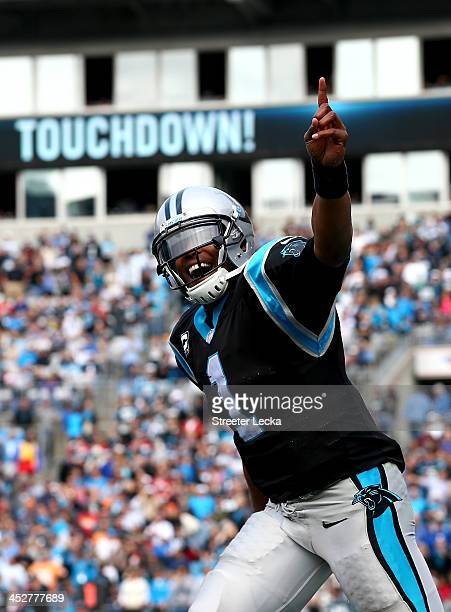Cam Newton of the Carolina Panthers celebrates after running for a touchdown against the Tampa Bay Buccaneers during their game at Bank of America...