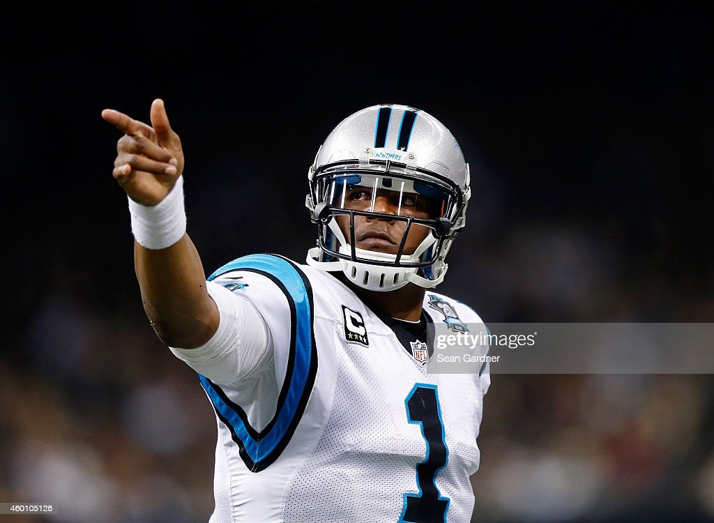 Cam Newton #1 of the Carolina Panthers celebrates after scoring a touchdown in the first half against the New Orleans Saints at Mercedes-Benz Superdome on December 7, 2014 in New Orleans, Louisiana.