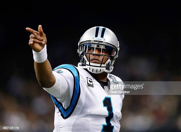 Cam Newton of the Carolina Panthers celebrates after scoring a touchdown in the first half against the New Orleans Saints at MercedesBenz Superdome...