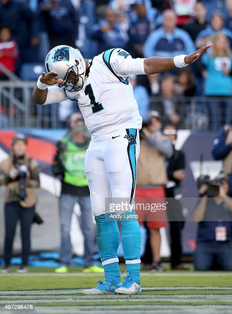 Cam Newton of the Carolina Panthers celebrates after scoring a touchdown during the second half against the Tennessee Titans at LP Field on November...