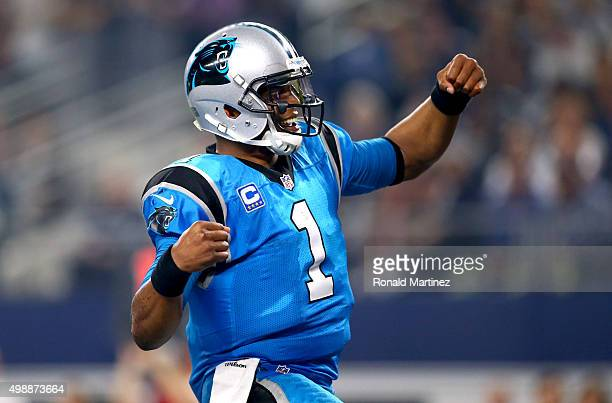 Cam Newton of the Carolina Panthers celebrates after scoring a touchdown against the Dallas Cowboys in the second half at ATT Stadium on November 26...